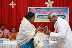 Sree O Rajagopal presented Memento and 'Ponnada' at Gandhi Smrithi Bhavan
